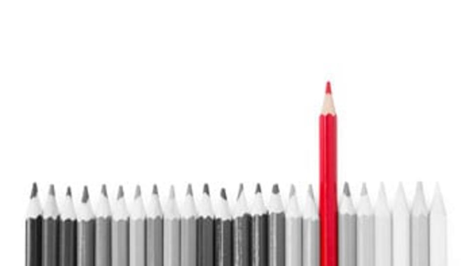 Black and White Photo of Pencils with One Red Pencil