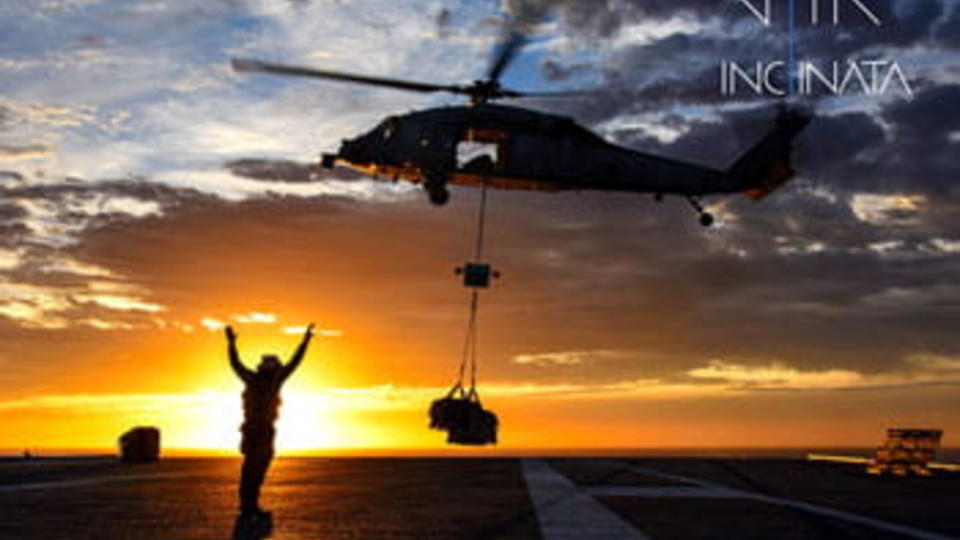 Sunrise with person waving up to helicopter